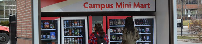 Two students using the Campus Mini Mart.